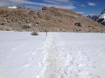 Footprints in the snow, descending from Mueller Hut.
